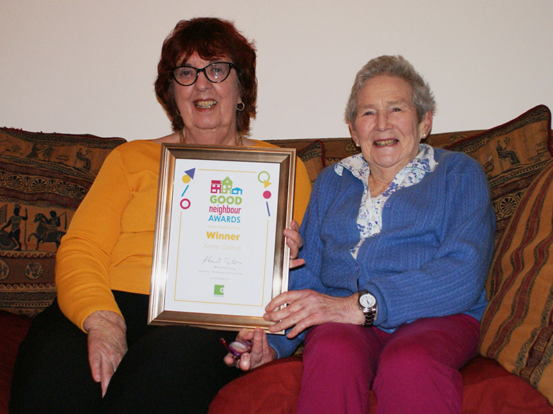 Anne (left) receiving her Good Neighbour Award from her neighbour Connie (right)