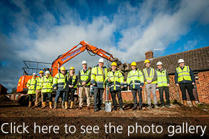 Staff from GreenSquare and E G Carter & Co Ltd mark the start of construction