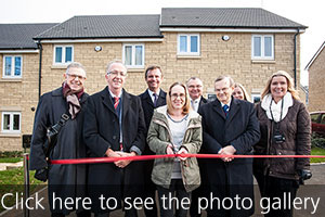 GreenSquare and Lion Court staff join resident, Nicola, to cut the ribbon to declare the new homes officially open